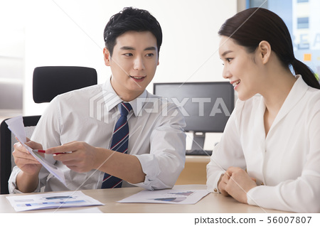 Office life concept, two asian business partners working in office 245 56007807