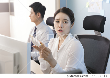 Office life concept, two asian business partners working in office 101 56007814