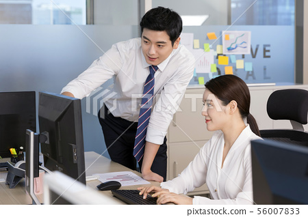 Office life concept, two asian business partners working in office 109 56007833