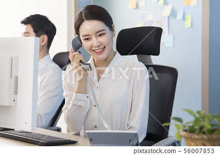 Office life concept, two asian business partners working in office 204 56007853