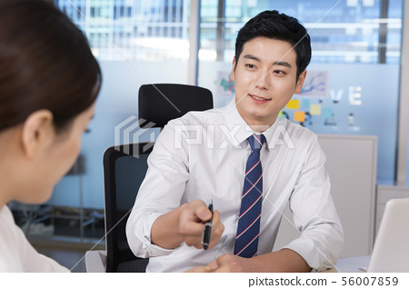 Office life concept, two asian business partners working in office 049 56007859