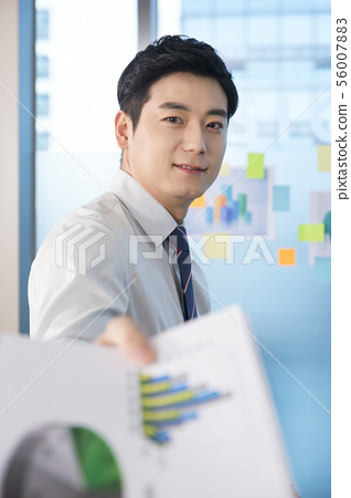 Office life concept, two asian business partners working in office 135 56007883