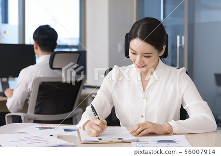 Office life concept, two asian business partners working in office 105 56007914