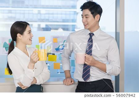 Office life concept, two asian business partners working in office 162 56007942