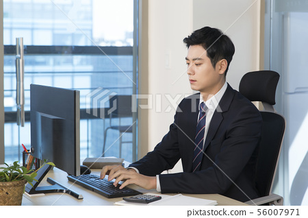 Office life concept, two asian business partners working in office 082 56007971
