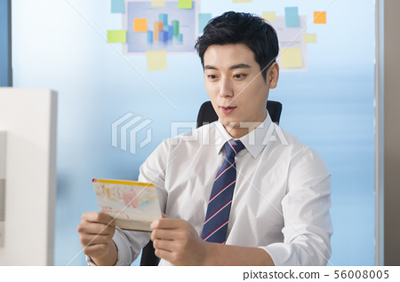 Office life concept, two asian business partners working in office 125 56008005