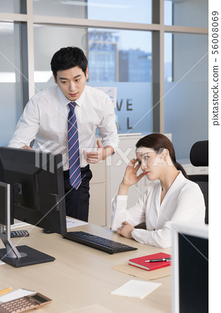 Office life concept, two asian business partners working in office 053 56008069