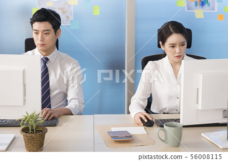 Office life concept, two asian business partners working in office 048 56008115