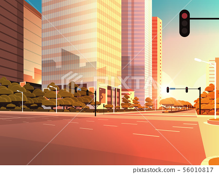 beautifil city street asphalt road with traffic light high skyscraper modern cityscape sunset 56010817