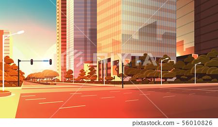 asphalt road with marking arrows traffic signs city skyline modern skyscraper cityscape sunset 56010826