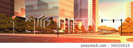 beautifil city street asphalt road with traffic light high skyscraper modern cityscape sunset 56010828