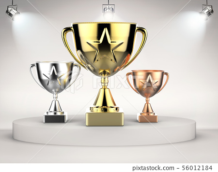 gold, silver and bronze trophy on stage 56012184