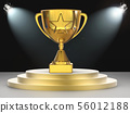 gold star trophy on stage 56012188