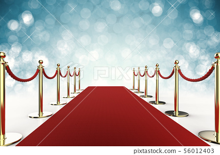 red carpet with rope barrier on blue background 56012403