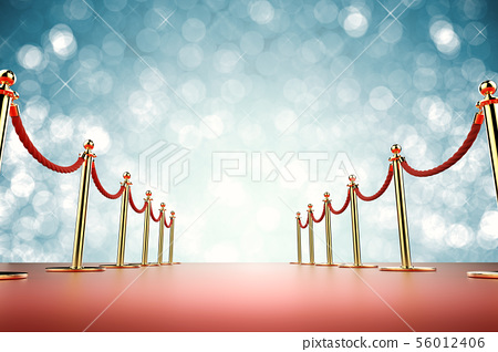 red carpet with rope barrier on blue background 56012406