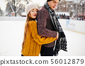Cute couple in a ice arena 56012879