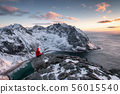 Mountaineer sightseeing on ridge with arctic ocean 56015540