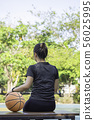 Basketball in hand Asian woman Background tree. 56025995