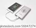 USB charger plugged in to smart phone 56047274