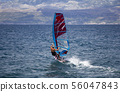 Young windsurfer in the waves in the sea 56047843