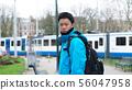 Asian man travel Europe backpack Amsterdam, tram 56047958