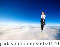 Young businesswoman in formal wear flying in blue sky. 56050120
