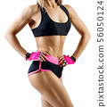 Unrecognizable athletic woman in sportswear demonstrated her muscular body. 56050124