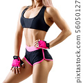 Unrecognizable athletic woman in sportswear demonstrated her muscular body. 56050127