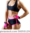 Unrecognizable athletic woman in sportswear demonstrated her muscular body. 56050129