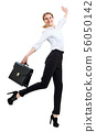 Happy business woman in formal wear jumping with briefcase. 56050142