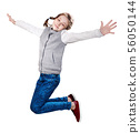 Cute smiling little girl jumping up. 56050144
