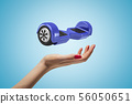 Female hand with blue hoverboard above on blue background 56050651