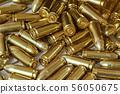 Heap of yellow brass gun bullets closeup 56050675