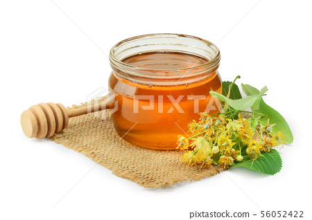 Linden flowers with leaf and honey isolated on white background 56052422