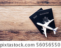 top view  passport  on wooden table, for travel 56056550