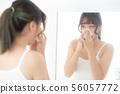 Beautiful young asian woman using tissue sheet 56057772