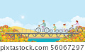Family are riding on bicycles on bridge in autumn. 56067297