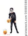 little girl holding jack o lantern pumpkin basket 56089380