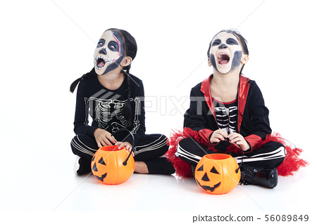 children trick or treating on white background 56089849