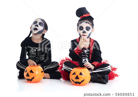 children trick or treating on white background 56089851