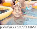 Boy swimming in pool 56118651