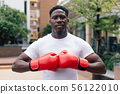 Muscular male boxer in boxing gloves 56122010