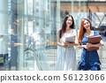 Two asian student walking to library in her 56123066