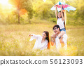 Asian family father, mother and daughter play ta 56123093