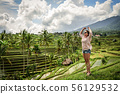 Woman looking at beautiful rice terrace 56129532