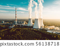 A Power plant with white smoke over it's chimneys 56138718