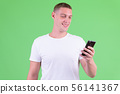 Portrait of happy young man using phone 56141367