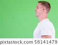 Closeup profile view of happy young man smiling 56141479