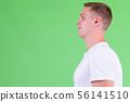 Closeup profile view of young man wearing white shirt 56141510