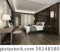 bedroom suite in hotel with tv and working table 56148380
